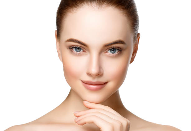 Beautiful woman face with make up and beauty healthy skin and hair portrait. stock photo