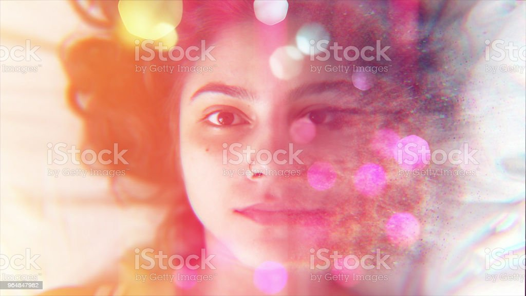 Beautiful Woman Face with Particles royalty-free stock photo