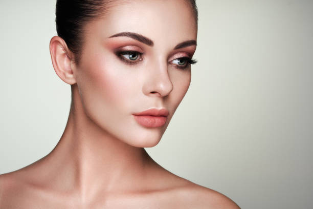 Beautiful woman face with perfect makeup Beautiful Young Woman with Clean Fresh Skin. Perfect Makeup. Beauty Fashion. Eyelashes. Cosmetic Eyeshadow. Highlighting. Cosmetology, Beauty and Spa stage make up stock pictures, royalty-free photos & images