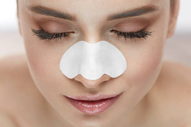 Beautiful Woman Face With Skin Care Patch On Nose stock photo