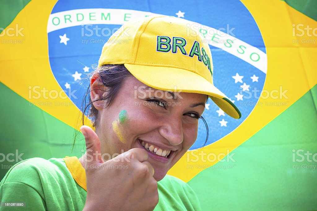 Beautiful Woman Fan of Brasil Football Team with Thumbs Up royalty-free stock photo