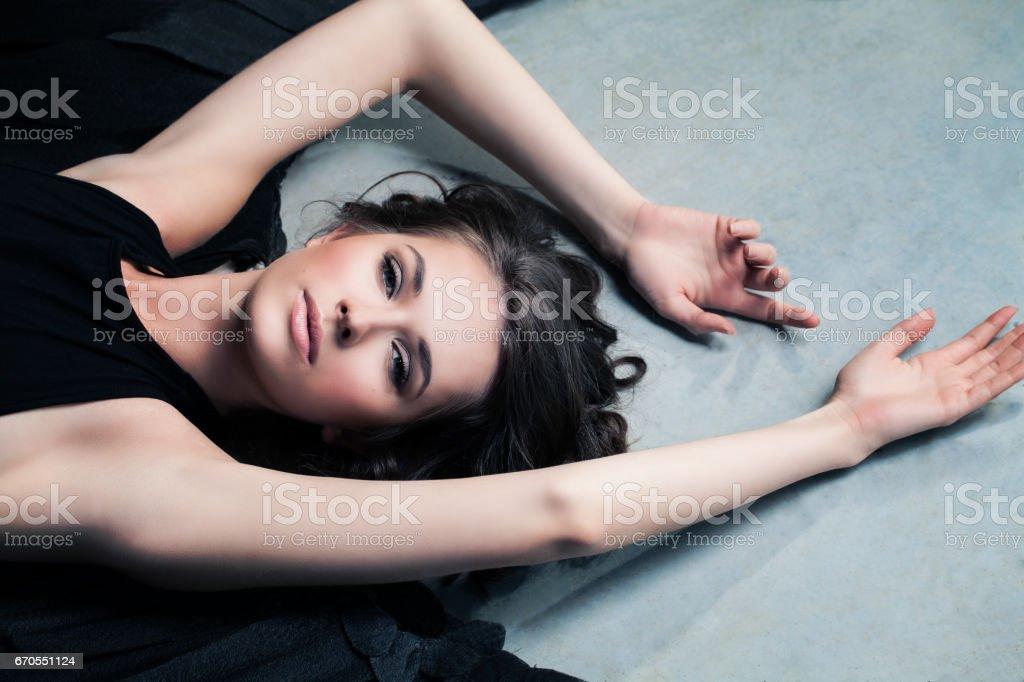 Beautiful Woman Fashion Model Black Angel Relaxing stock photo
