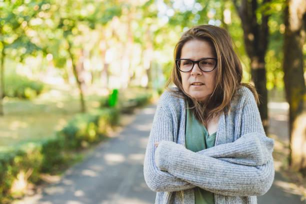 Beautiful woman feeling cold outside stock photo