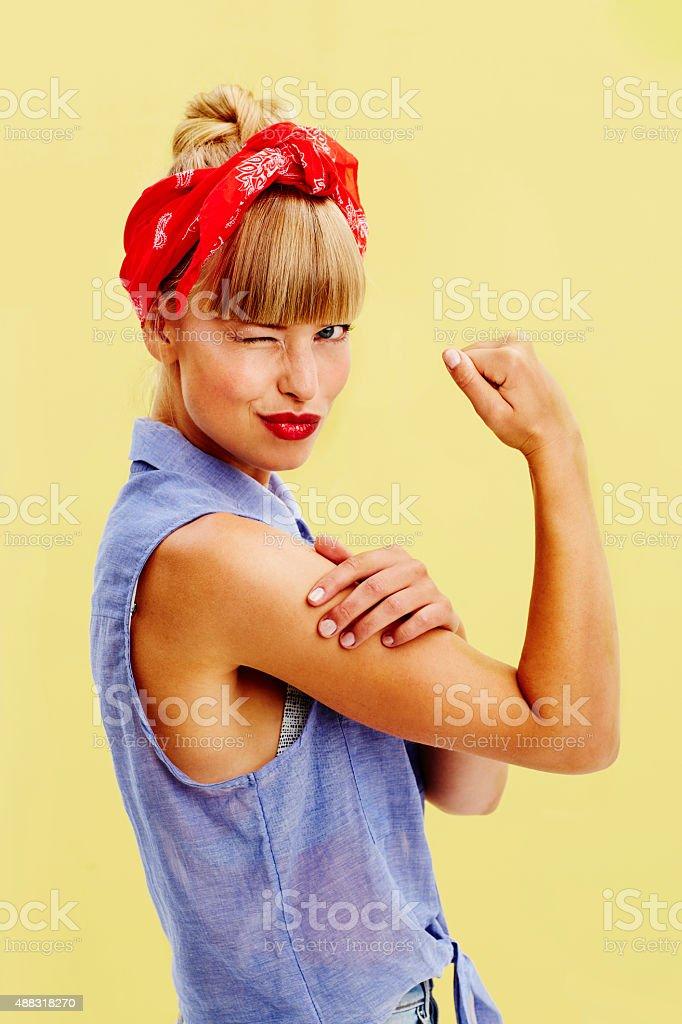 Beautiful woman flexing muscle stock photo