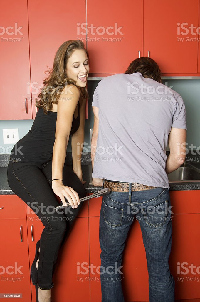 Beautiful Woman Flirting In the Kitchen royalty-free stock photo