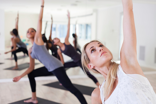 Beautiful Woman Focusing As She Does Yoga Stock Photo - Download Image Now