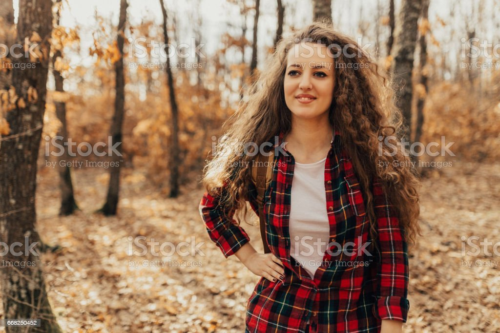 Beautiful woman from country side standing in the forest foto stock royalty-free