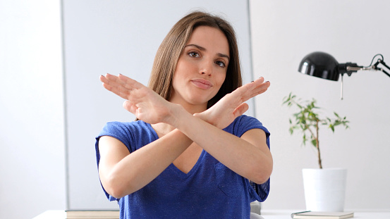 Beautiful Woman Gesturing Rejection Refusal Of Offer Stock Photo - Download Image Now
