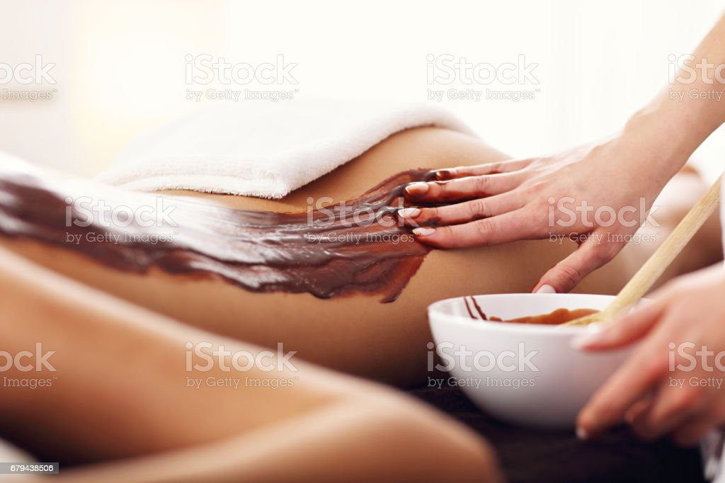 Beautiful woman getting chocolate massage in spa royalty-free stock photo