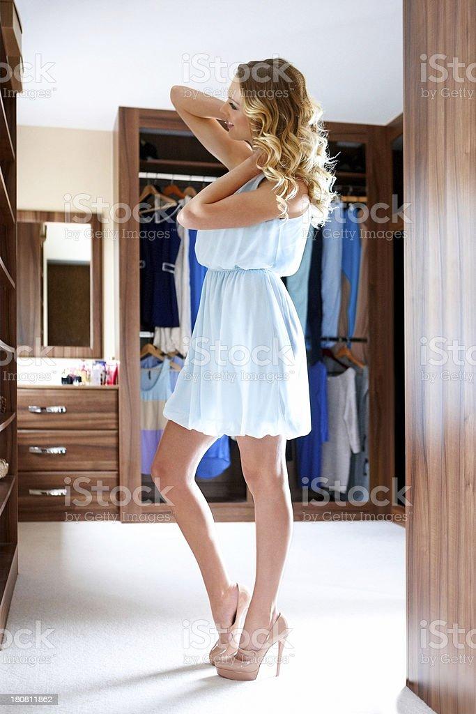 Beautiful woman getting dressed stock photo