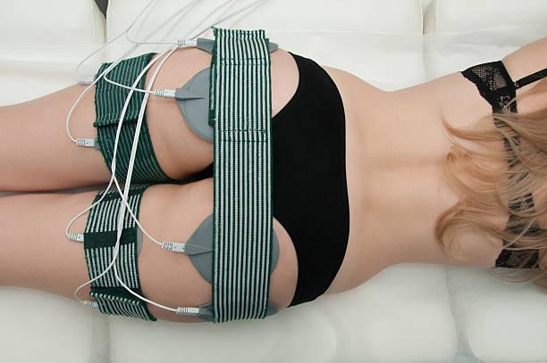 Beautiful woman getting electro stimulation therapy stock photo