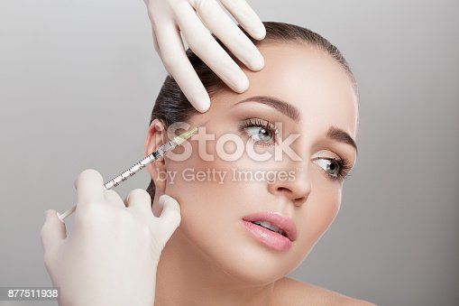 istock beautiful woman getting injection 877511938