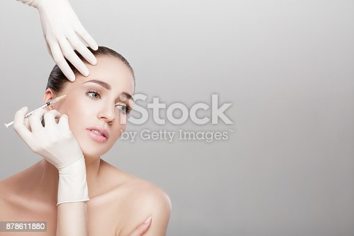 istock beautiful woman getting injection 878611880