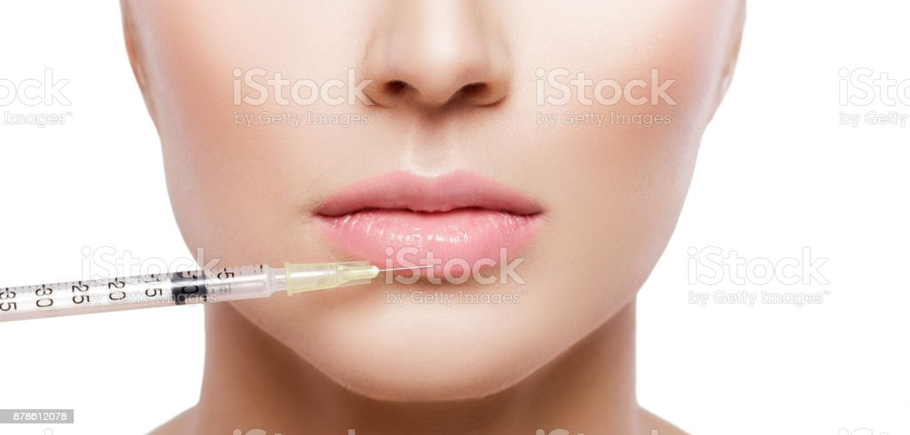 beautiful woman getting injection stock photo