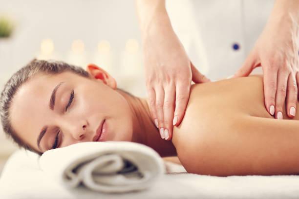 Beautiful woman getting massage in spa stock photo