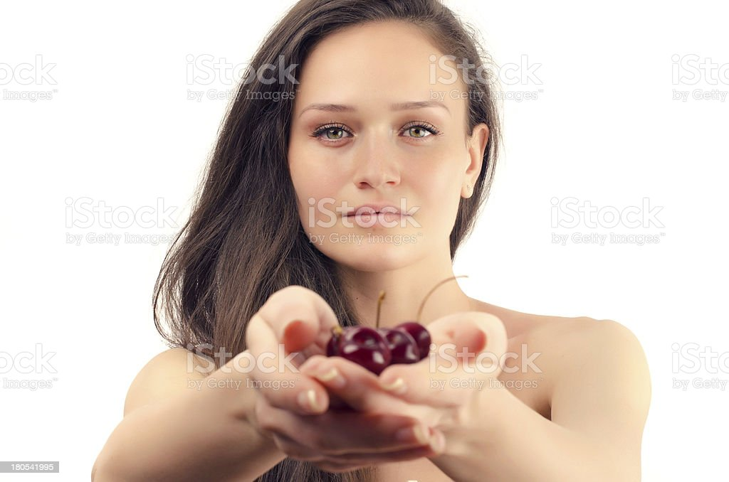 Beautiful woman giving a cherry for healty life stock photo