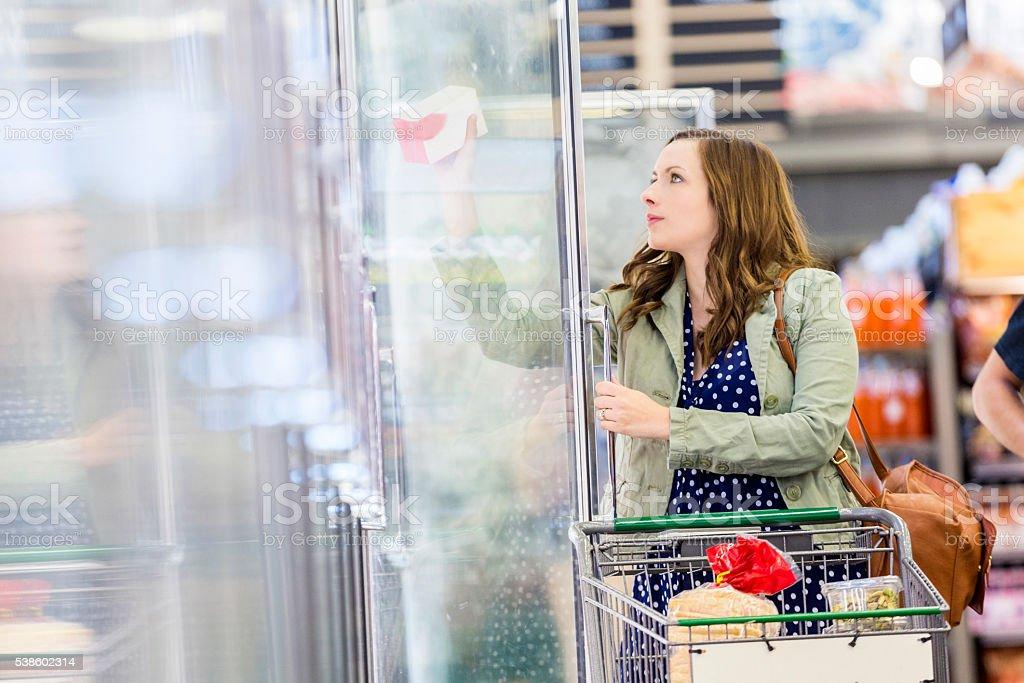 Beautiful woman grocery shopping stock photo