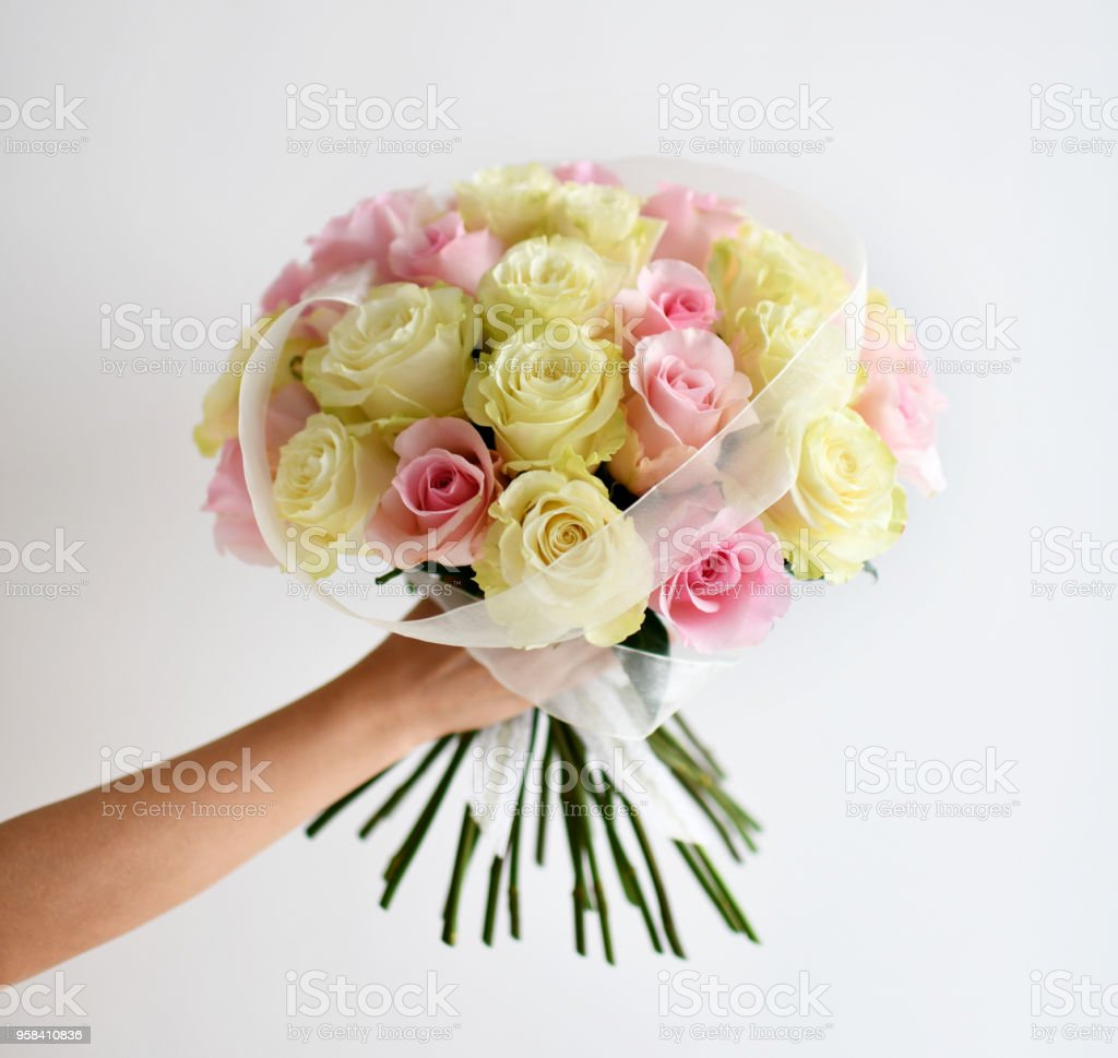 Beautiful woman hand hold bouquet of yellow and pink roses flowers beautiful woman hand hold bouquet of yellow and pink roses flowers on white royalty free izmirmasajfo