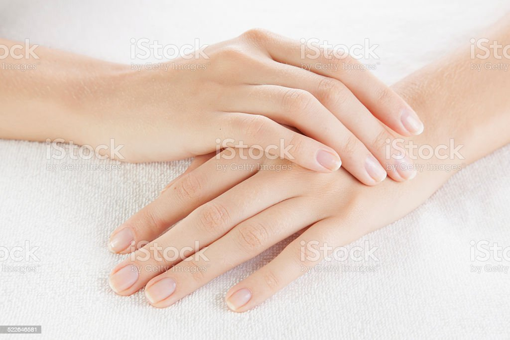 Beautiful woman hands are on a towel stock photo