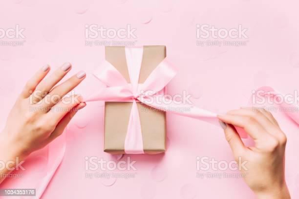 Beautiful woman hands with beautiful manicure open gift box picture id1034353176?b=1&k=6&m=1034353176&s=612x612&h= y5kpppzykba3bzngocwk3s fdwu y0dz z38hxydye=