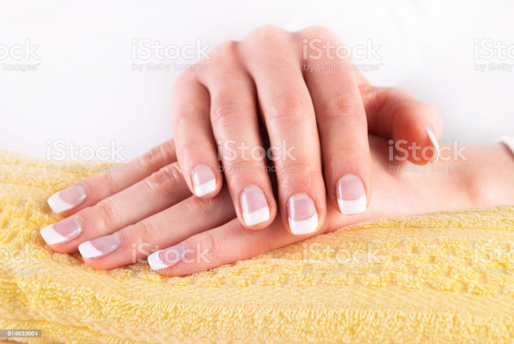 Beautiful Woman Hands With French Nails Manicure On Yellow