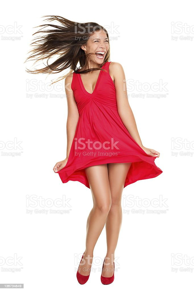 Beautiful woman happy screaming in red dress stock photo