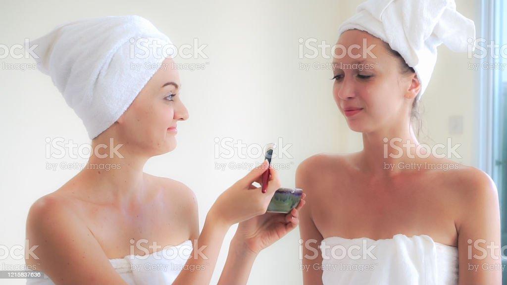 Beautiful Woman Having A Facial Cosmetic Scrub Treatment At