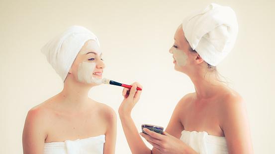 istock Beautiful woman having a facial treatment at spa. 1254738807