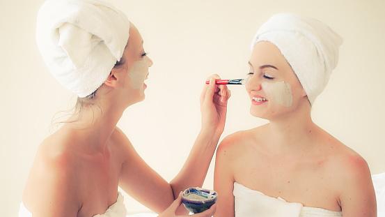 istock Beautiful woman having a facial treatment at spa. 1254741449