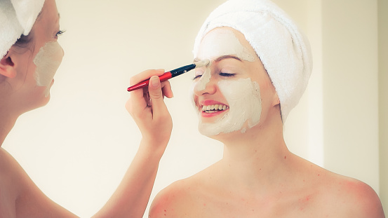 istock Beautiful woman having a facial treatment at spa. 1254741513