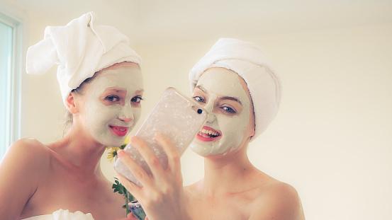 istock Beautiful woman having a facial treatment at spa. 1254741695