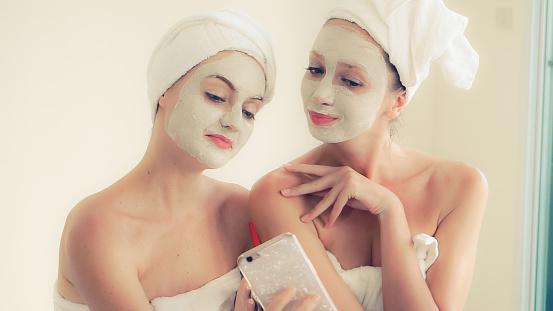 istock Beautiful woman having a facial treatment at spa. 1254741904