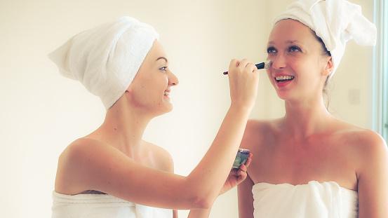 istock Beautiful woman having a facial treatment at spa. 1254741946