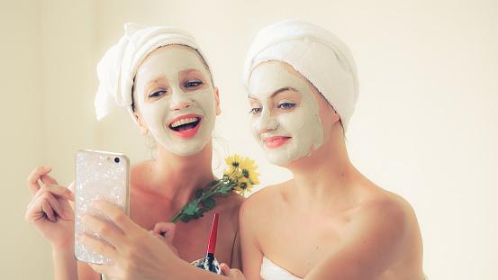 istock Beautiful woman having a facial treatment at spa. 1254741990