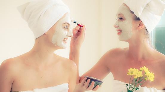 istock Beautiful woman having a facial treatment at spa. 1254742654