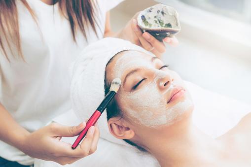 istock Beautiful woman having a facial treatment at spa. 994319222