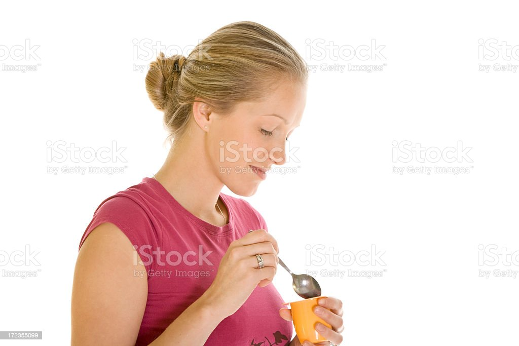 Beautiful woman having a yoghurt royalty-free stock photo