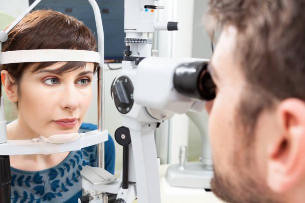 Beautiful woman having an eye exam stock photo