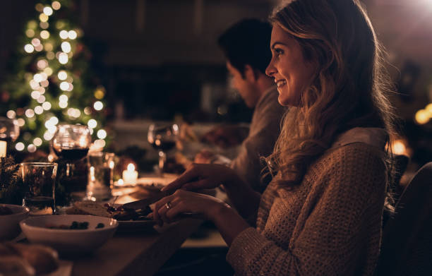 Beautiful woman having christmas dinner with family - foto stock
