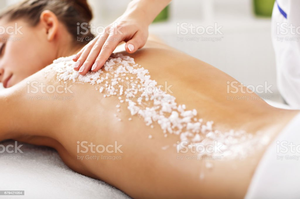 Beautiful woman having exfoliation treatment in spa stock photo