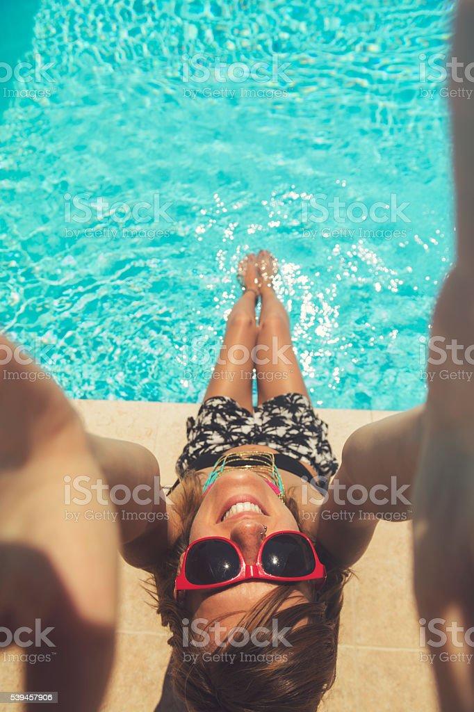 Beautiful woman having fun on the pool. stock photo