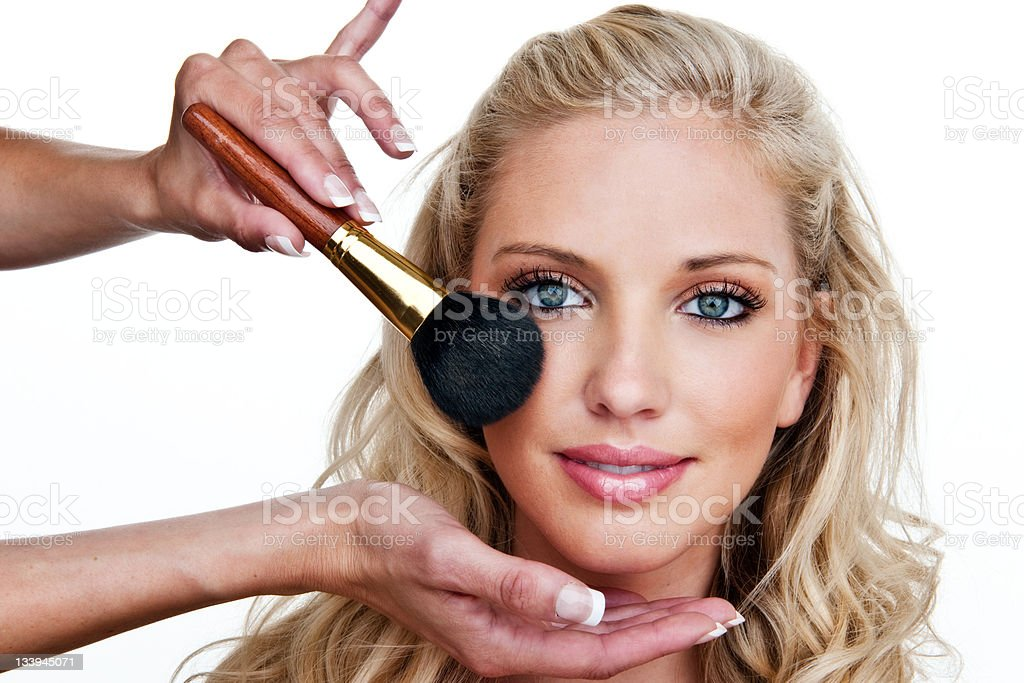 Beautiful woman having makeup applied royalty-free stock photo