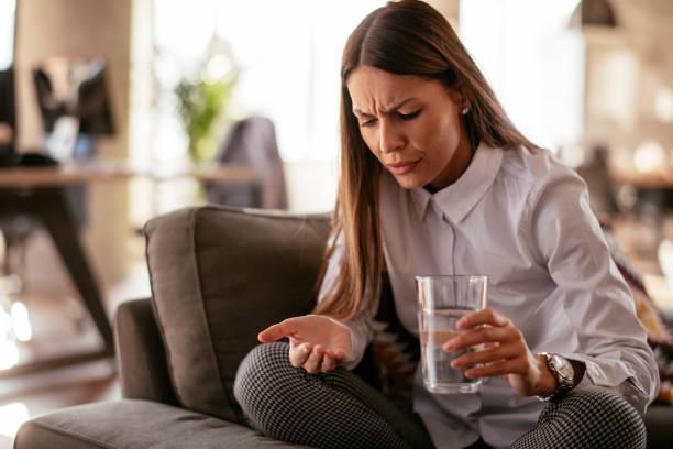 Beautiful woman having pills stock photo