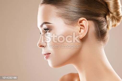 Beautiful woman healthy skin care concept portrait close up on beige background. Studio shot.