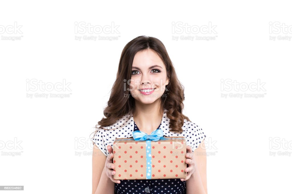 Beautiful woman hold a gift with a gift, isolated. foto de stock royalty-free