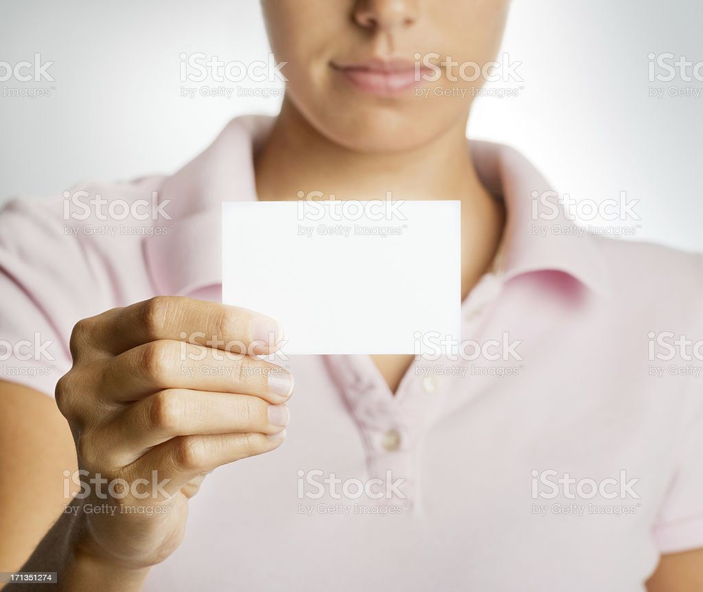 Beautiful woman holding a blank Business Card royalty-free stock photo