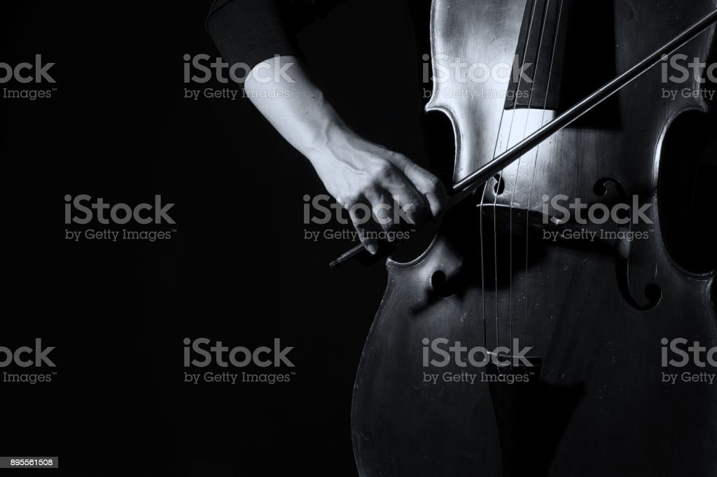 Beautiful Woman Holding A Cello With Selective Light In Black Dress