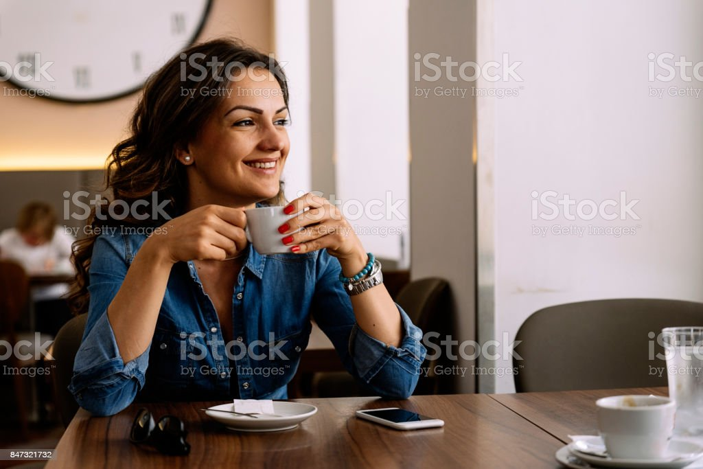 Beautiful woman holding a cup of coffee. royalty-free stock photo