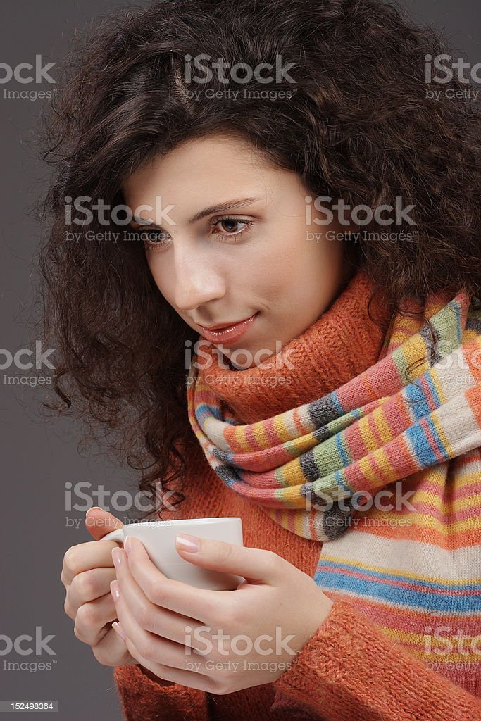 Beautiful woman holding a cup of tea royalty-free stock photo