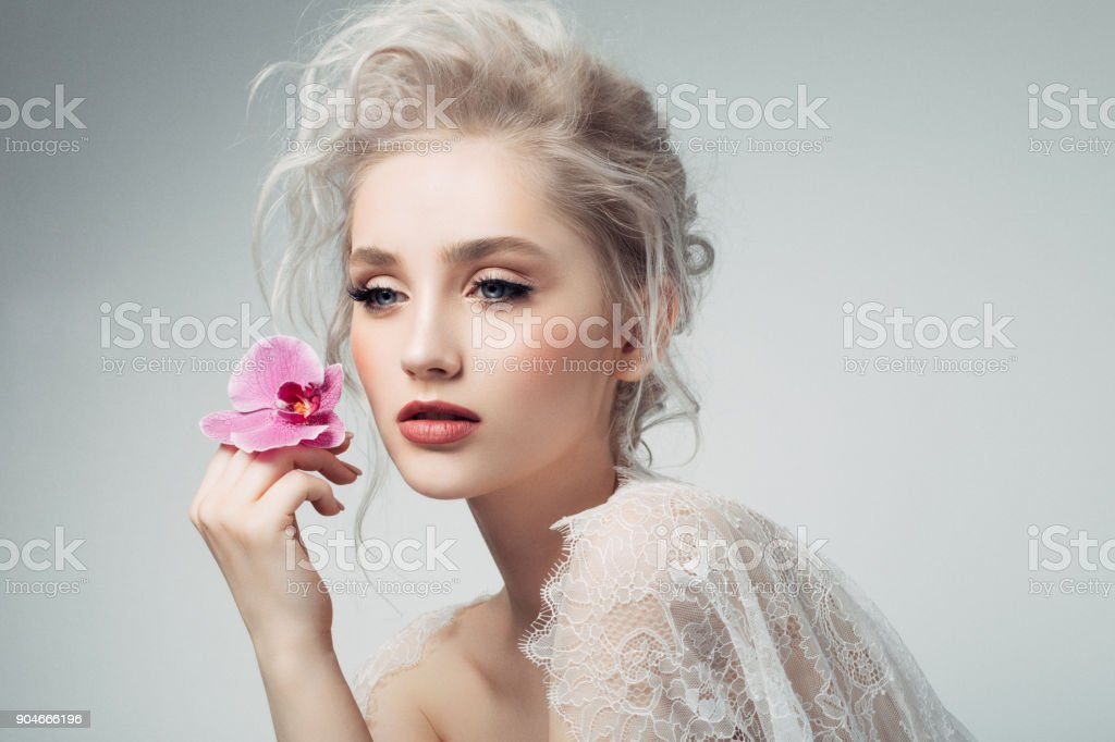 Beautiful woman holding a flower stock photo